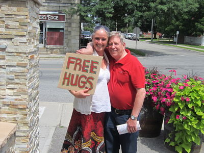 Dennis Marks receives his free hug from Peer Advocate Joanne Cassidy